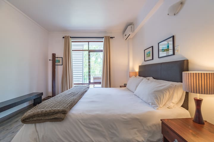 The apartment has one bedroom, which features an extra-length king size bed.