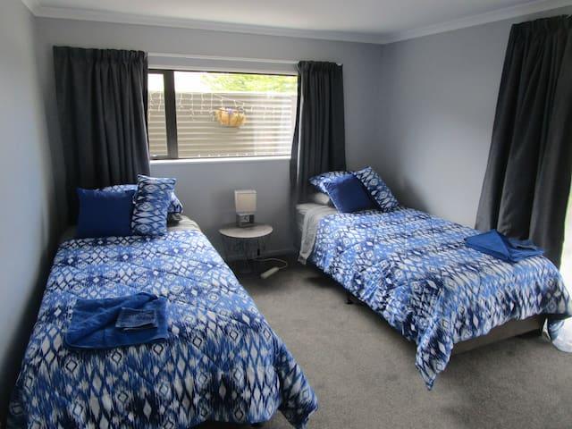 Bedroom 2. Two king singles downstairs.