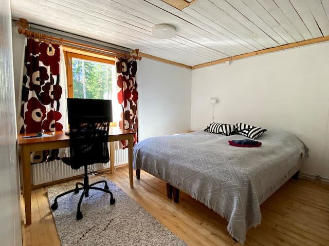 Bedroom #3 with a double bed. The room is also equipped with remote work equipment: desk and chair, monitor with HDMI cable, mouse and keyboard.