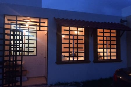 Photo was taken before house was painted and garage walls built. But entry way and off street parking area is well lit.