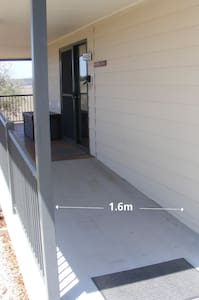 A wide gentle ramp leads to the front door.