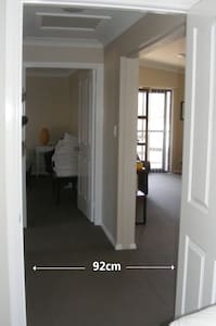 No steps. The hallway to the bedrooms and bathroom is nearly a metre wide with all doorways measuring 92cm rather than the standard 72cm.
