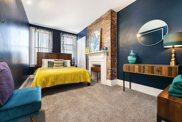 Bright & colorful, the first bedroom features a queen mattress, and welcomes you in for a relaxing evening.