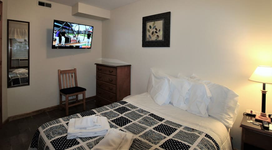"""Bedroom #2 with full bed - smart Roku TV (43"""" or larger) in every bedroom."""