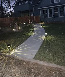 Lighted pathway to garden gate.