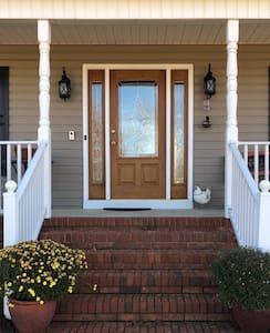 Well lit entryway front porch, sidewalk