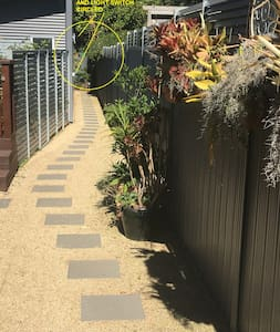Access pathway is minimum one metre in width with minimal slope and external light and light switch (as circled)