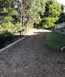The wide gravel ramp provides good vehicular access to house ramp