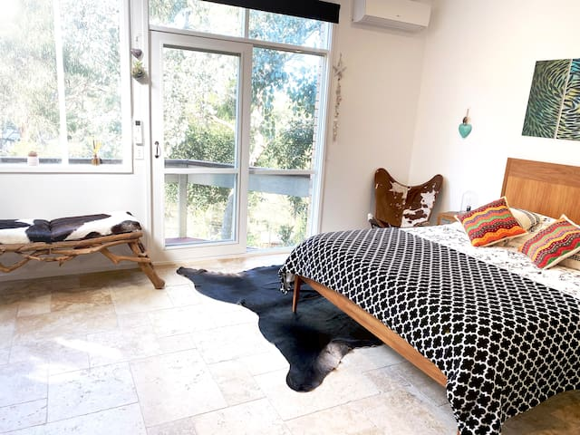 A gorgeous room to wake up in with views over the gumtrees. This Airbnb is warm, with two big split system heaters. There is nothing worse than booking cold accommodation, rest assured you will not be cold here!