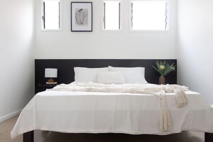 first bedroom. comfortable queen bed.