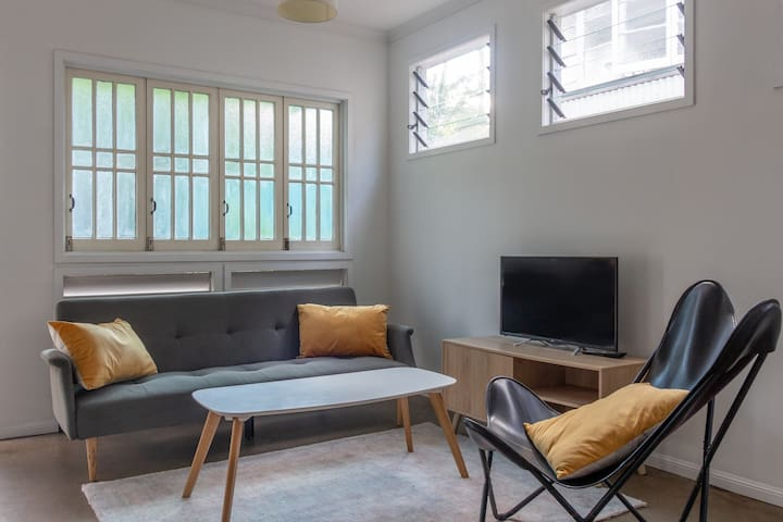 comfortable living space. The casement windows open to your own courtyard in the front.
