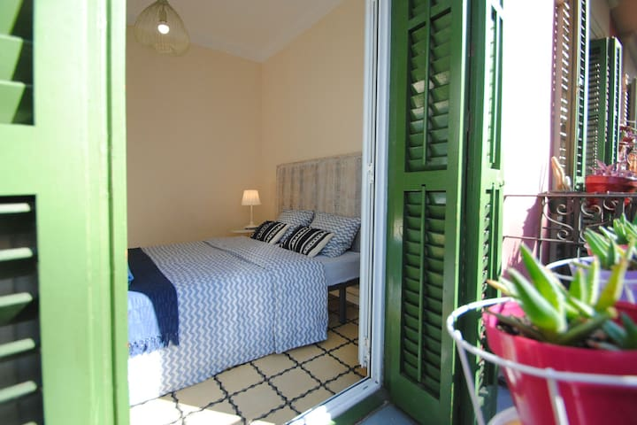 Second bedroom with double bed and the wide window, welcoming Spanish sun! Who likes fresh morning breeze?...If you are a light sleeper, just use the shades to stop the sunlight Enjoy it,  respecting the rest of the neighbours in the evening!
