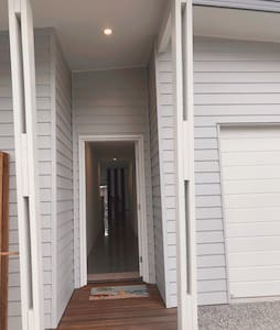 Main Entrance. To the right is a wide driveway and therefore easy access to front door