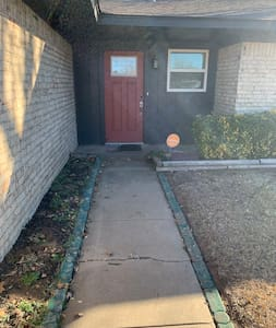 Easy entrance. No steps or curbs. There is a motion porch light.