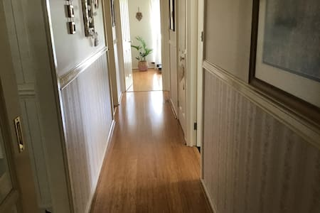 Hallway to guest bedroom on left. Ahead is the guest sitting room.