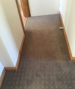 The photo shows a short hallway leading to the bathroom and toilet. 90 cms of the length measure 85cms the remainder 95 cms.