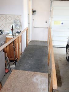 This is in the garage. I hope to have a nicer one on a new deck off the parking area this summer. You can still enjoy the deck now by going out the kitchen door.