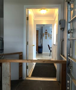 The garage light comes on when the door is opened, flooding area with light. The hallway and kitchen are also well lit. A pole light illuminates the parking area.