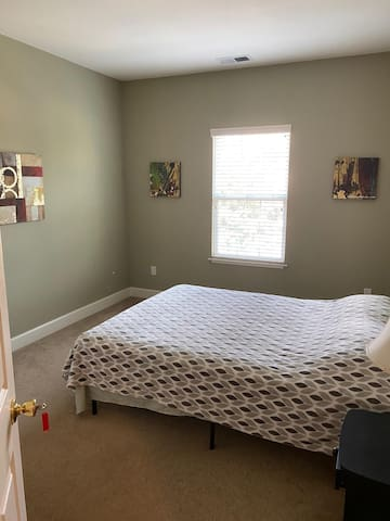 Clean and Quaint Bedroom with Shared Bath