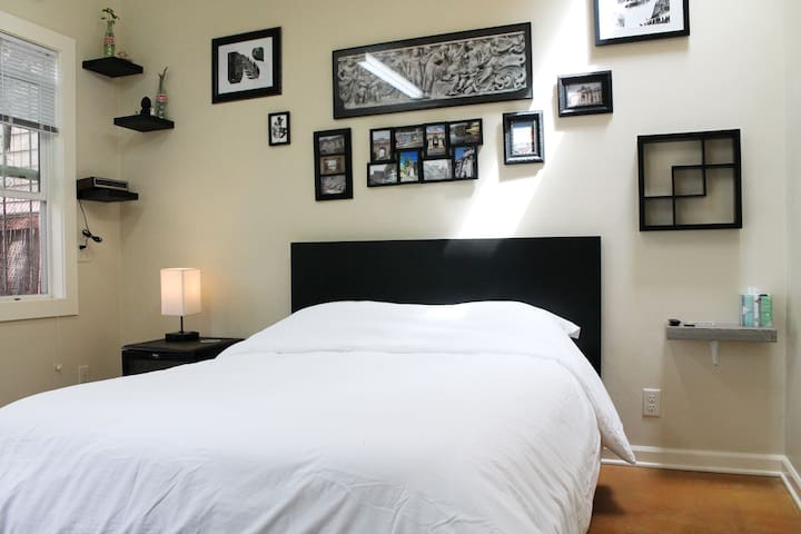Comfy full bed with side table that doubles as fridge