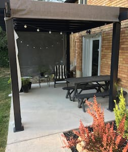 There are lights on the patio, as well as solar powered path lights along the walkway, and a motion sensor light that turns on as you turn the corner to the backyard while walking down the path.