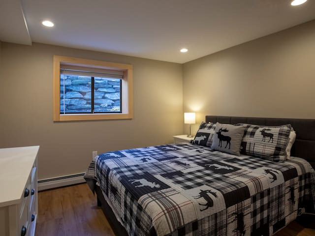 Queen sized bed in the second bedroom. Two twin sized foam floor mattresses are available for overflow guests.