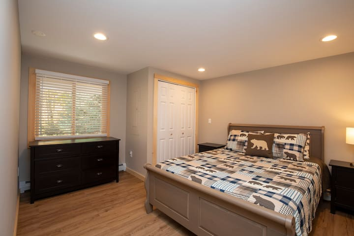 Queen sized bed in the front bedroom. Two twin sized foam floor mattresses are available for overflow guests.