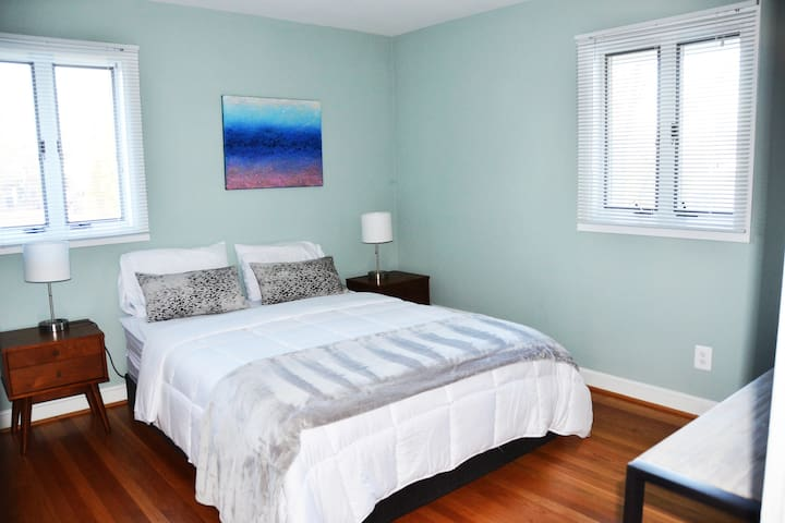 Master bedroom, furnished with brand new pillows, bed sheets, comforter, blanket, TV, connected to master bath