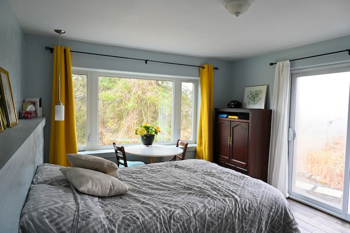 Large private room, with two large windows providing beautiful views onto the property. In-floor radiant heating and electric baseboard for your comfort in winter.