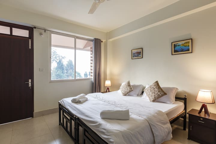 Master Bedroom -  The Master bedroom comes with an attached balcony and is heated. We provide with the comfort of premium linens and essential toiletries.