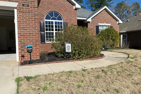Flat entrance from the driveway or garage to the front door.