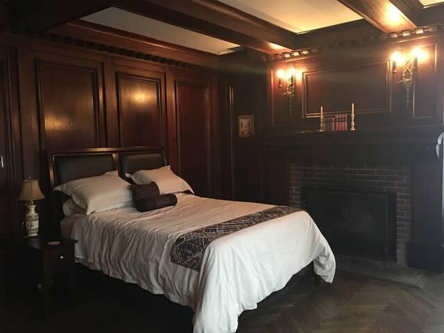 The Mahogany bedroom with mahogany paneling