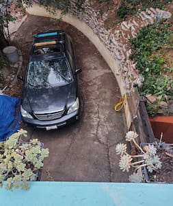 driveway leads up to the keyless entry gate
