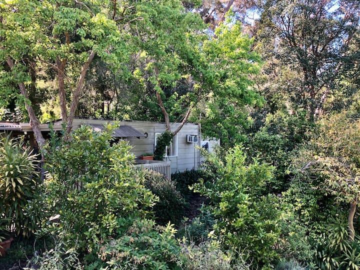 Cabin set in beautiful gardens