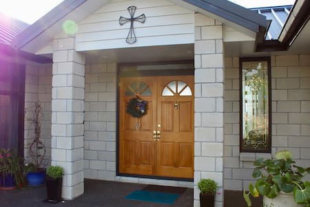 Main entrance to Arohanui BnB. Double doors. However you will notice a small ledge at the main door. If this is inconvenient there is a totally flat access through the garage.