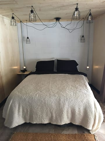 Queen bed in the newly renovated walkout basement! See the ski hill from bed!