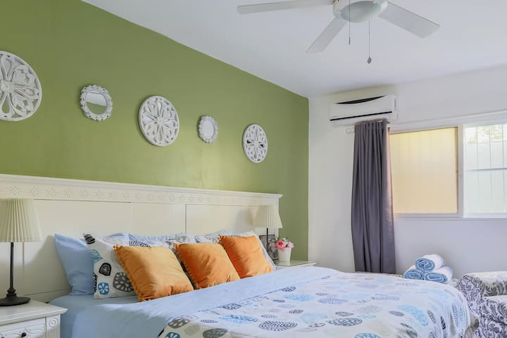 Master bedroom Layout. King size bed and Smart TV.  Air conditioner and ceiling fan.