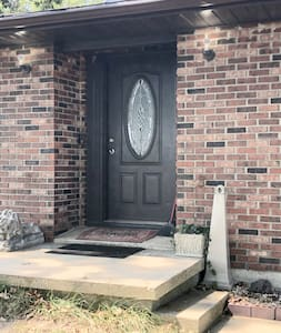 The outside entranceway is very well lit from driveway to door.