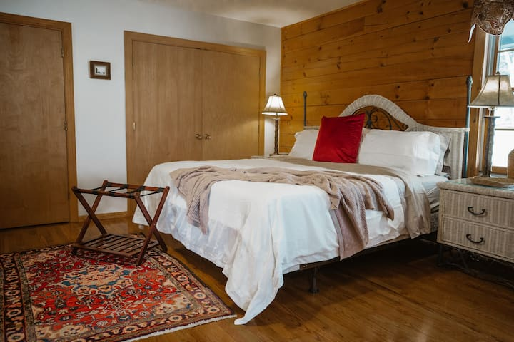 King bedroom featuring en suite bathroom and two closets for guest use.