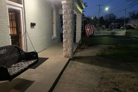 This is the front entrance of the home with the porch light on.