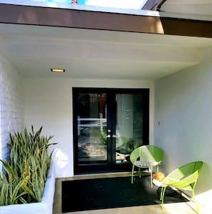 """Wide double door entrance with tiny 3"""" step up to a level interior space."""