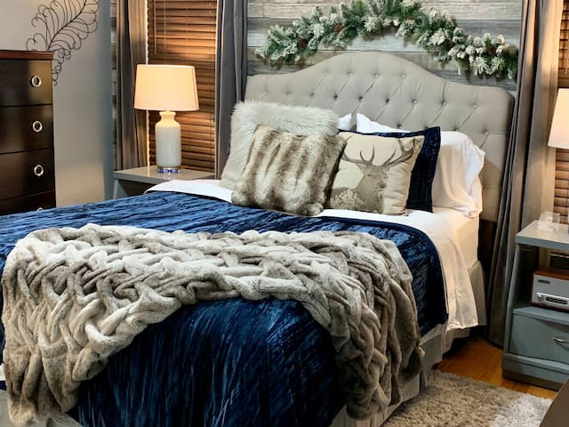 Enjoy all the comforts of Home!  Bedroom has closet, hangers, iron, and ironing board.  Bedroom has everything you need for short or extended stays!  Queen size bed,  dresser, and chest of drawers.   Please note:  bedding and decor may be different.