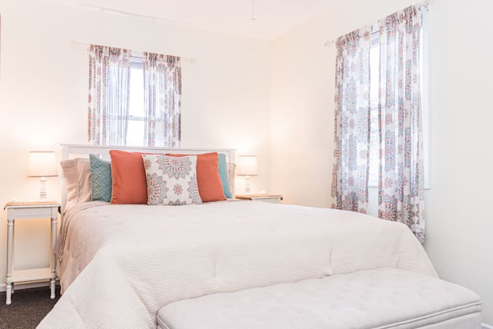 Bright & Sunny Bedroom / New Queen Pillowtop Mattress / Cozy Linens / Blackout Shades / Full Closet with Hangers