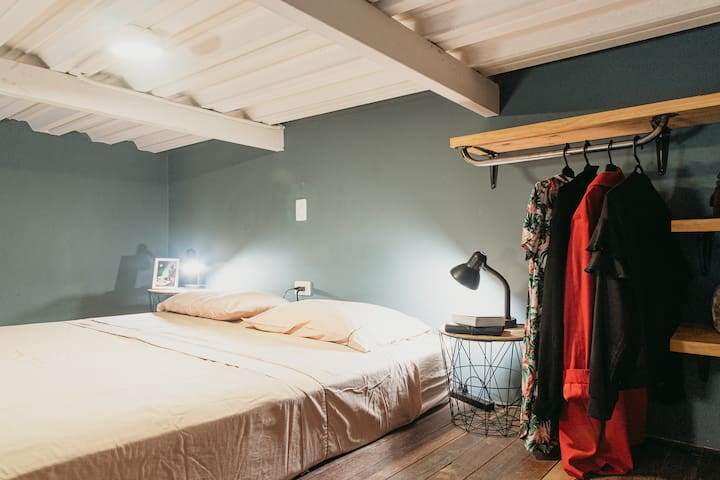 Dormitory with queen sized bed and reading lights