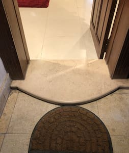 A very small step when entering the appartment
