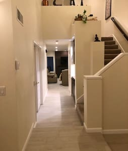 This is the downstairs hallway; there is a step at the base of the staircase.
