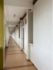 Well lit corridor leads to the unit