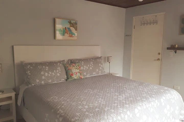 Comfy king bed in the master bedroom for a great night sleep.