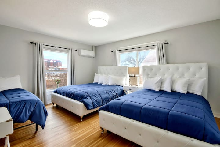 Huge windows accent our bright and cheery Navy Room.