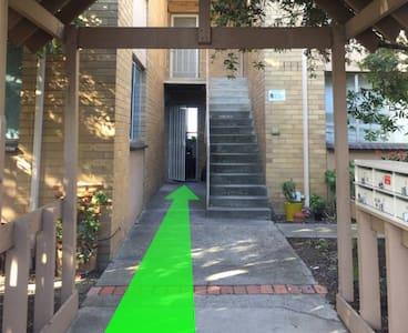 Flat entry towards apartment door.